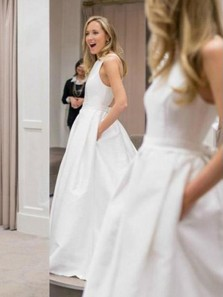 Simple A-line Round Neck Cross Back White Satin Long Wedding Dresses with Pockets