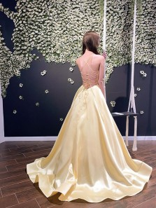 Charming A-Line V Neck Criss Cross Back Daffodil Satin Long Prom Dresses with Pockets