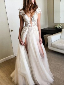 Charming A-Line V Neck Cap Sleeve Backless Ivory Tulle Wedding Dresses with Lace
